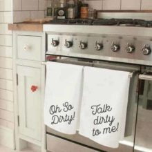 Naughty Novelty Tea Towel set. Twin white tea towel set printed in black with 'Oh So Dirty' and 'Talk Dirty To Me'.